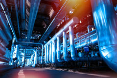 Industrial Steel pipelines and cables in blue tones Stock Photography