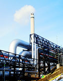 Industrial Steel pipelines smokestack blue sky Royalty Free Stock Photography