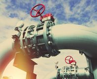 Industrial Steel pipelines and valves against blue sky Royalty Free Stock Photo