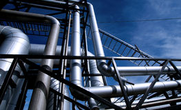 Industrial Steel pipelines and valves against blue sky Stock Image