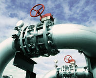 Industrial Steel pipelines and valves against blue sky Stock Photography