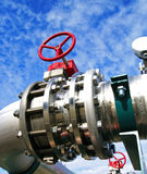 Industrial Steel pipelines and valves against blue sky Royalty Free Stock Photos