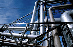 Industrial Steel pipelines and valves against blue sky Stock Photos