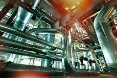 Industrial Steel pipelines and valves against blue sky Stock Images