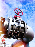 Industrial Steel pipelines and valves against blue sky Royalty Free Stock Image