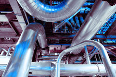 Industrial Steel pipelines, valves, cables and walkways Stock Photo