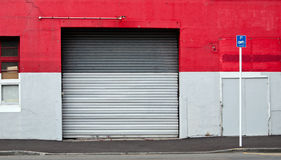 Industrial steel rolled door Stock Photography