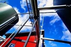 Industrial Steel tanks stairs against blue sky stock image