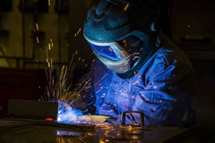 Industrial steel welder in factory. Welder, craftsman, erecting technical steel spark trained fabricate Royalty Free Stock Image
