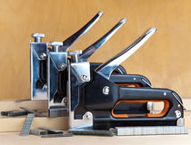 Industrial still life.metal stapler for repair work in the house Royalty Free Stock Image