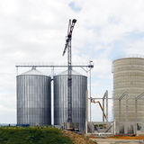 Industrial storage tanks. A large construction crane used to construct two new silos or industrial storage tanks Stock Image