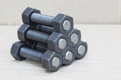 Industrial stud bolts on paper recycle background Royalty Free Stock Photography