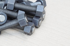 Industrial stud bolts on paper recycle background Royalty Free Stock Photos