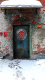 Industrial style door. Old door and walls and contrasting bright colors Stock Photography