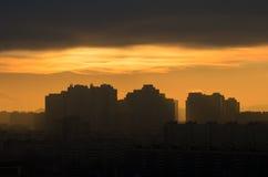 Industrial sunrise Silhouette city sun light dooms day sky sunrise sunset building industrial sun clouds factory.  Stock Photography