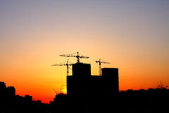 Industrial Sunset. Construction of a major housing project at sunset Royalty Free Stock Photo