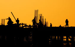 Industrial Sunset. Construction workers at a sunset stock photos