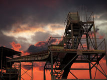 Industrial sunset - gravel works silhouetted Royalty Free Stock Photo