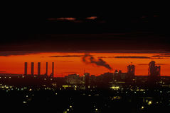 Industrial sunset with smokestacks over Newark, NJ Royalty Free Stock Image