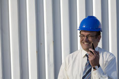 Industrial surveyor talking on his radio Stock Photo