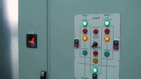 Industrial switching button and light on control panel. Clip. Instrument panel at the factory.  stock video footage