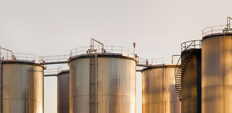 Industrial tanks. Large tanks for petrol and oil at the sunset Royalty Free Stock Images