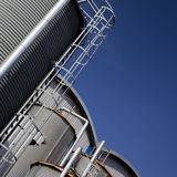 Industrial tanks and buildings. Various industrial holding tanks or storage silos and buildings stock photo