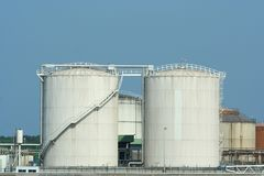 Industrial tanks on quayside Royalty Free Stock Photos