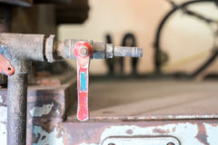 Industrial tap valve setting of old rustic machine Stock Photo