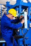 Industrial technician repairing Stock Photo