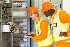 Industrial technicians control box status. Professional industrial technicians checking control box status with laptop computer Stock Photo