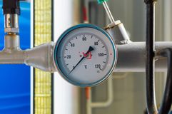 Industrial thermometer in boiler room. Concept of accident interruptions in heating and hot water supply. Industrial thermometer in boiler room. Concept of Royalty Free Stock Images