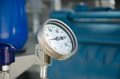 Industrial thermometer. New shiny industrial thermometer in boiler room Royalty Free Stock Photos