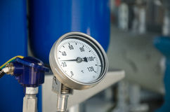 Industrial thermometer. New shiny industrial thermometer in boiler room Stock Photography