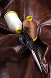 Industrial thread bobbins with scissor Royalty Free Stock Image