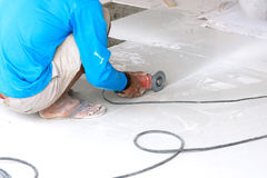 Industrial tiler builder worker working with floor tile cutting equipment Royalty Free Stock Image