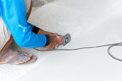 Industrial tiler builder worker working with floor tile cutting equipment Royalty Free Stock Images