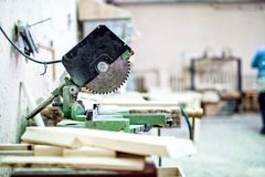 Industrial tool in wood and metal factory, compound mitre saw. With sharp, circular blade stock image