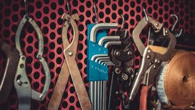 Industrial Tools Kit Hanging On wall royalty free stock photography