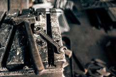 Industrial tools in old factory, metal table with mechanic wrench and hammer royalty free stock photography