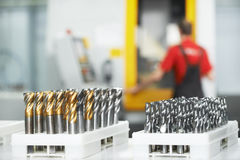 Industrial tools at workshop. Industrial cutting tools in front of cnc milling machine center in tool workshop manufacturing Stock Photography