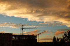 Industrial tower crane on a construction site and building Royalty Free Stock Image