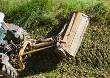 Industrial tractor with mowin . Stock Photos