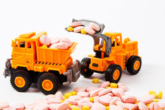 Industrial tractor toy load Pill Stock Photography