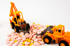 Industrial tractor toy load Pill Royalty Free Stock Photo