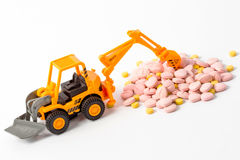 Industrial tractor toy load Pill. Close up royalty free stock images