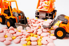 Industrial tractor toy load Pill. Close up royalty free stock photos