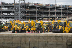 Industrial tractors and cars await export from docks UK Royalty Free Stock Photos