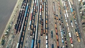 Industrial  train depot near Ploiesti , Romania , aerial view. Aerial drone shot showing  many colored freight train cars and oil tanks with petrochemical stock video