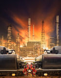 Industrial trains and railways against heavy petrochemical indus Royalty Free Stock Image